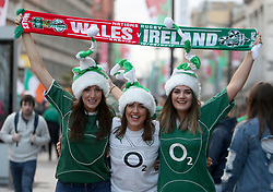 Irish fans pose with a half-and-half scarf prior to the RBS Six Nations at the Principality Stadium, Cardiff. PRESS ASSOCIATION Photo. Picture date: Friday March 10, 2017. See PA story RUGBYU Wales. Photo credit should read: David Davies/PA Wire. RESTRICTIONS: Use subject to restrictions. Editorial use only. No commercial use. No use in books or print sales without prior permission.