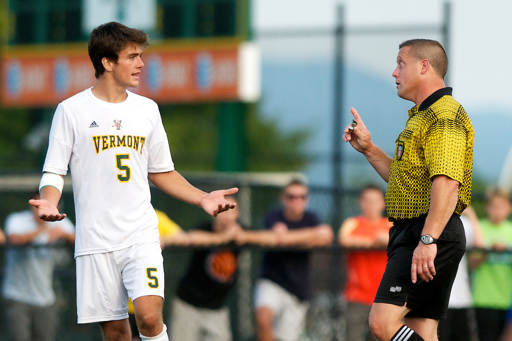 Catamounts midfielder Charlie DeFeo (5) has words with the referee during the men's soccer game between the Central Connecticut State University Blue Devils and the Vermont Catamounts at Virtue Field on Friday afternoon September 7, 2012 in Burlington, Vermont.