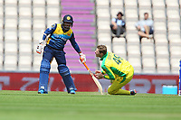 Cricket - 2019 ICC Cricket World Cup warm ups - Australia vs. Sri Lanka<br /> <br /> Steve Smith of Australia fails to catch a low ball whilst bowling only to take a hit to the groin during the cricket world cup warm up match at the Hampshire Bowl Southampton England<br /> <br /> COLORSPORT/SHAUN BOGGUST
