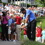 K.J. Choi, South Korea, plays out of the rough on the 14th watched by a large crowd during the final round of the Travelers Championship at the TPC River Highlands, Cromwell, Connecticut, USA. 22nd June 2014. Photo Tim Clayton