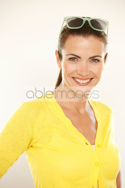 Smiling Woman with Sunglasses on top of Head