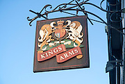 Close-up of pub sign for the Kings Arms against blue sky, Weymouth, Dorset, England