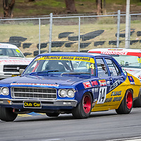 Grant Hill leads Howard Crump and Anthony Fogliani onto the main straight at Wanneroo Raceway during the HQ Holden race of the WA State Championship round hosted by the WA Sporting Car Club.