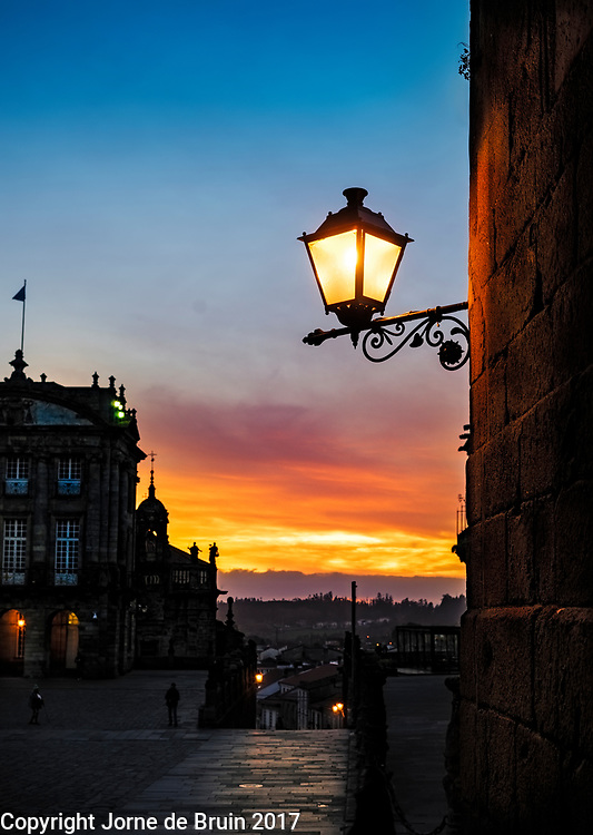 Sunset in the main square of Santiago de Compostela in Spain shot under a streetlight in the old center.