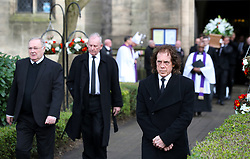 Retired Stoke City player Mike Pejic (right) during the funeral service for Gordon Banks at Stoke Minster.