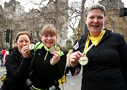 Runners pose with their medals after completing the 2018 London Landmarks Half Marathon. PRESS ASSOCIATION Photo. Picture date: Sunday March 25, 2018. Photo credit should read: Steven Paston/PA Wire