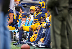 Nov 23, 2019; Morgantown, WV, USA; West Virginia Mountaineers wide receiver Sam James (13) watches from the bench during the third quarter against the Oklahoma State Cowboys at Mountaineer Field at Milan Puskar Stadium. Mandatory Credit: Ben Queen-USA TODAY Sports