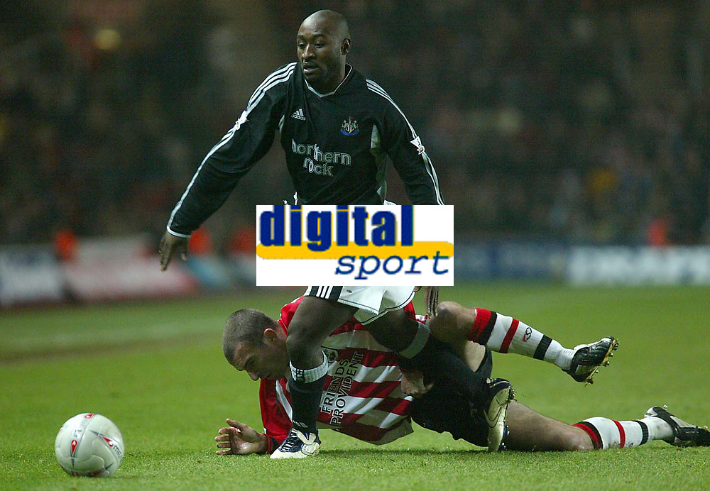 Photo. Andrew Unwin.<br /> Southampton v Newcastle United, FA Cup Third Round, Friends Provident St Marys Stadium, Southampton 03/01/2004.<br /> Southampton's Danny Higginbottom is unable to stop Newcastle's Lomana Lualua.