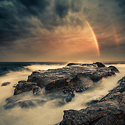 Breaking storm sunset with forming rainbow, Gerringong, South Coast, NSW, Australia