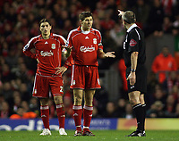 Photo: Paul Thomas.<br /> Liverpool v Arsenal. Carling Cup. 09/01/2007.<br /> <br /> Steven Gerrard (C) of Liverpool has words to referee Mr M Atkinson (R).