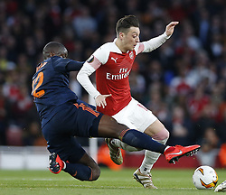 BRITAIN-LONDON-FOOTBALL-UEFA EUROPA LEAGUE-ARSENAL VS VALENCIA.(190502) -- LONDON, May 2, 2019  Arsenal's Mesut Ozil (R) is tackled by Valencia's Mouctar Diakhaby during the UEFA Europa League semi-final first leg match between Arsenal and Valencia at The Emirates Stadium in London, Britain on May 2, 2019. Arsenal won 3-1.  FOR EDITORIAL USE ONLY. NOT FOR SALE FOR MARKETING OR ADVERTISING CAMPAIGNS. NO USE WITH UNAUTHORIZED AUDIO, VIDEO, DATA, FIXTURE LISTS, CLUB/LEAGUE LOGOS OR ''LIVE'' SERVICES. ONLINE IN-MATCH USE LIMITED TO 45 IMAGES, NO VIDEO EMULATION. NO USE IN BETTING, GAMES OR SINGLE CLUB/LEAGUE/PLAYER PUBLICATIONS. (Credit Image: © Matthew Impey/Xinhua via ZUMA Wire)