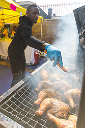 London, August 28 2017. A man cooks jerk chicken, staple of the Notting Hill carnival on Day Two of Europe's biggest street party held over two days of the August bank holiday weekend, attracting over a million people. © Paul Davey.