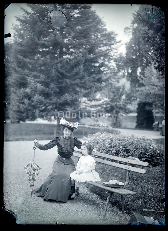 mother with child posing in garden setting France ca 1910s
