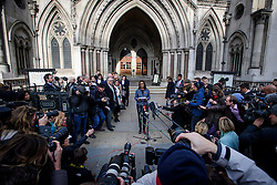 © Licensed to London News Pictures. 03/11/2016. London, UK. Campaigner GINA MILLER reads a statement outside the High Court after a ruling was announced on her Brexit legal challenge. Ms Miller and other campaigners launched a legal challenge, after the EU referendum result, to force the government to seek Parliamentary approval before Brexit negotiations begin. Photo credit: Ben Cawthra/LNP