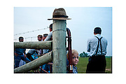 Jessie Rhodes hangs out with the men at a Mennonite youth outing.<br /> <br /> Old Order Mennonite is a term for the Mennonite groups who dress plainly and reject modern technologies. They put the disciplined church community, rather than individual religious experience, at the center of their Christian faith.  <br /> <br /> Most Old Order Mennonites use a horse-drawn buggy for transportation. There are no heaters in most Mennonite buggies so they wear winter coats and use blankets for warmth.<br /> <br /> Date: August 28, 2008.