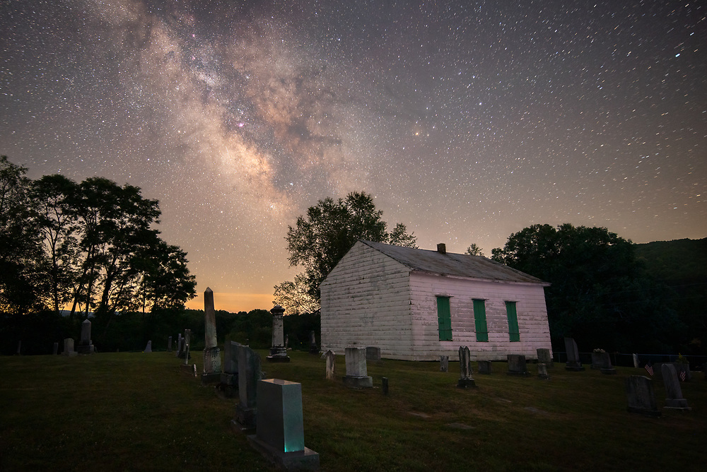 The Old Droop Church, built in 1865, is surrounded by grave sites as old as the church itself and the Milky Way under clear dark, starry West Virginia skies.