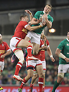 Garry Ringrose of Ireland and Matt Evans  of Canada jump for the ball during the 2016 Guinness Series  autumn international rugby match, Ireland v Canada at the Aviva Stadium in Dublin, Ireland on Saturday 12th November 2016.<br /> pic by  John Halas, Andrew Orchard sports photography.
