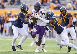 Nov 14, 2020; Morgantown, West Virginia, USA; TCU Horned Frogs running back Kendre Miller (33) runs the ball during the third quarter against the West Virginia Mountaineers at Mountaineer Field at Milan Puskar Stadium. Mandatory Credit: Ben Queen-USA TODAY Sports