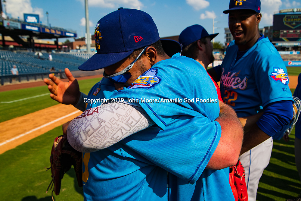 Amarillo Sod Poodles Manager Phillip Wellman and Amarillo Sod Poodles outfielder Edward Olivares (11) celebrates after the Sod Poodles won against the Tulsa Drillers during the Texas League Championship on Sunday, Sept. 15, 2019, at OneOK Field in Tulsa, Oklahoma. [Photo by John Moore/Amarillo Sod Poodles]