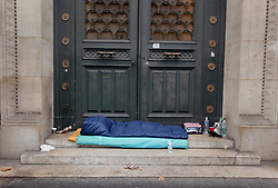 19 January 2019. Paris, France.<br /> Gilets Jaunes - Acte X take to the streets of Paris. Passing a homeless person's sleeping bag along the way. An estimated 7,000 people took part in the looping 14 km route from Place des Invalides to protest tax hikes from the Government of Emmanuel Macron imposed on the people. An estimated 80,000 people took part in protests across the country. Regrettably the movement has attracted a violent element of agitators who often face off with riot police at the end of the marches which tends to deflect attention away from the message of the vast majority of peaceful protesters.<br /> Photo©; Charlie Varley/varleypix.com