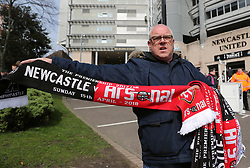 Merchant outside selling scarves outside the ground prior to kick-off during the Premier League match at St James' Park, Newcastle.