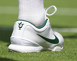 LONDON, ENGLAND - Tuesday, June 21, 2011: The Nike tenns shoe of Roger Federer (SUI) depicting his six Wimbledon Singles' titles during the Gentlemen's Singles 1st Round match on day two of the Wimbledon Lawn Tennis Championships at the All England Lawn Tennis and Croquet Club. (Pic by David Rawcliffe/Propaganda)