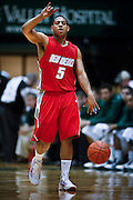 SHOT 2/23/10 10:22:17 PM - New Mexico's Dairese Gary signals a play to teammates during the second half of their regular season Mountain West Conference game against Colorado State at Moby Arena in Fort Collins, Co. New Mexico survived a tight game winning 72-66. Gary led the Lobos with 23 points in the game. (Photo by Marc Piscotty / © 2010)