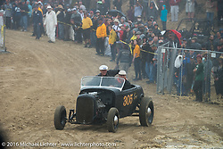 Bruce Woodward riding onto the beach in his hotrod at TROG West - The Race of Gentlemen. Pismo Beach, CA, USA. Saturday October 15, 2016. Photography ©2016 Michael Lichter.