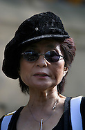 Yoko Ono attends a photocall on the steps of St Luke's Cathedral under one of her controversial images which she has donated to the 3rd Liverpool Biennial, the UK's largest contemporary arts event which commences on September 18, 2004 and runs until November 28. The image is being used to promote the Biennial..