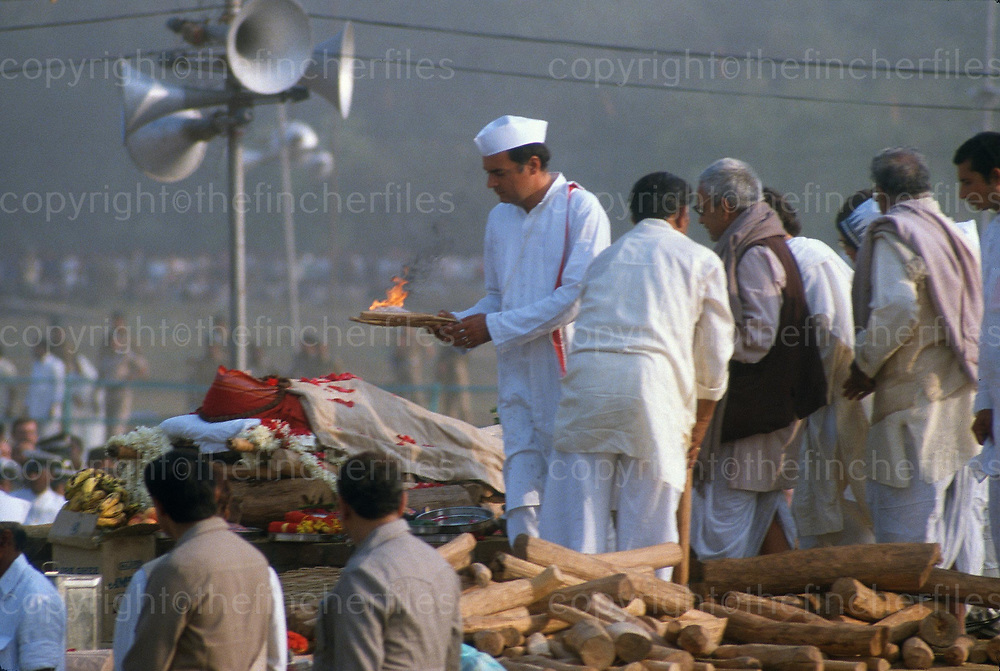 The State funeral of Indian prime Minister Indira Gandhi on 4th November 1984 at Raj Ghat,New Delhi,India. Rajiv Gandhi-son,gets ready to light the traditional funeral pyre.Photographed by Jayne Fincher