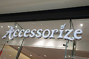 Sign for the clothing brand and accessory shop Accessorize in Birmingham, United Kingdom.