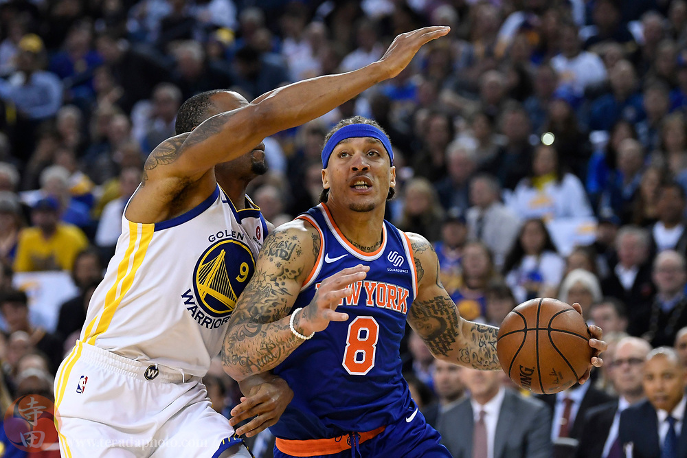 January 23, 2018; Oakland, CA, USA; New York Knicks forward Michael Beasley (8) dribbles the basketball against Golden State Warriors forward Andre Iguodala (9) during the first quarter at Oracle Arena.