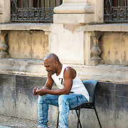 Man sitting on street in Old Havana