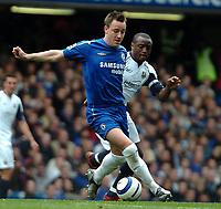 Photo: Ed Godden.<br />Chelsea v West Ham United. The Barclays Premiership. 09/04/2006. John Terry (L) and West Ham's Nigel Reo-Coker.