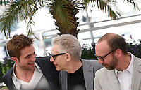 Robert Pattinson, David Cronenberg, Paul Giamatti,  at the Cosmopolis photocall at the 65th Cannes Film Festival France. Cosmopolis is directed by David Cronenberg and based on the book by writer Don Dellilo.  Friday 25th May 2012 in Cannes Film Festival, France.