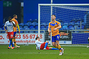 Ollie Clarke of Mansfield Town (8) reacts after seeing his shot go wide during the The FA Cup match between Mansfield Town and Dagenham and Redbridge at the One Call Stadium, Mansfield, England on 29 November 2020.