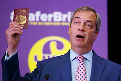 © Licensed to London News Pictures. 29/04/2016. London, UK. UKIP Leader Nigel Farage shows his passport whilst delivering a speech on EU referendum and explains security implications if Britain stays in the EU at the Emmanuel Centre in London on Friday, 29 April 2016. Photo credit: Tolga Akmen/LNP