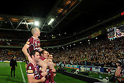 July 6th 2011: Maroons captain, Darren Lockyer is chaired from the filed by Cameron Smith and Ashley Harrison after game 3 of the 2011 State of Origin series at Suncorp Stadium in Brisbane, QLD, Australia on July 6, 2011. Photo by Matt Roberts / mattrimages.com.au / QRL