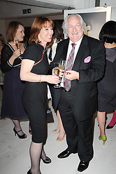 KAY BURLEY and SIR ERIC PEACOCK at a dinner hosted by Harper's Bazaar to celebrate Browns 40th Anniversary in aid of Women International held at The Regent Penthouses & Lofts, 16-18 Marshall Street, London on 20th May 2010.