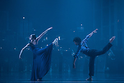 """© Licensed to London News Pictures. 12/05/2015. London, England. Pictured: Julia Gillespie and Miguel Altunaga. Rambert Dance Company perform the World Premiere of """"Dark Arteries"""" by Mark Baldwin as part of a triple bill at Sadler's Wells Theatre. Rambert perform with the Tredegar Town Band and the Rambert Orchestra from 12 to 16 May 2015. Photo credit: Bettina Strenske/LNP"""