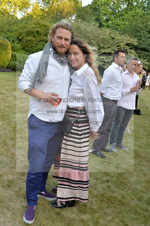 ALICE TEMPERLEY and GREG WILLIAMS at the Quintessentially Foundation and Elephant Family 's 'Travels to My Elephant' Royal Rickshaw Auction presented by Selfridges and hosted by HRH The Prince of Wales and The Duchess of Cornwall held at Lancaster House, Cleveland Row, St.James's, London on 30th June 2015.