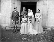 18/11/1952<br /> 11/18/1952<br /> 18 November 1952<br /> Wedding of Lieutenant Seamus Lillis, (son of Colonel James Lillis, Army Chief of Staff) Collins Barracks, Cork and Miss Aureed Mundy, Donegal at Ross Nuala and Bundoran, Co. Donegal. the couple with Bestman, Bridesmaid and flower girl outside the church at Ross Nuala.