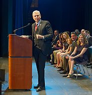 Hempstead, New York, USA. January 1, 2018. At podium, Hempstead Town Councilman BRUCE BLAKEMAN, a Republican, speaks at Swearing-In of LAURA GILLEN as Hempstead Town Supervisor, and SYLVIA CABANA as Hempstead Town Clerk, Hofstra University. Blakeman formally endorsed Gillen for the position. Gillen and Cabana sat with their families at left side of front row.
