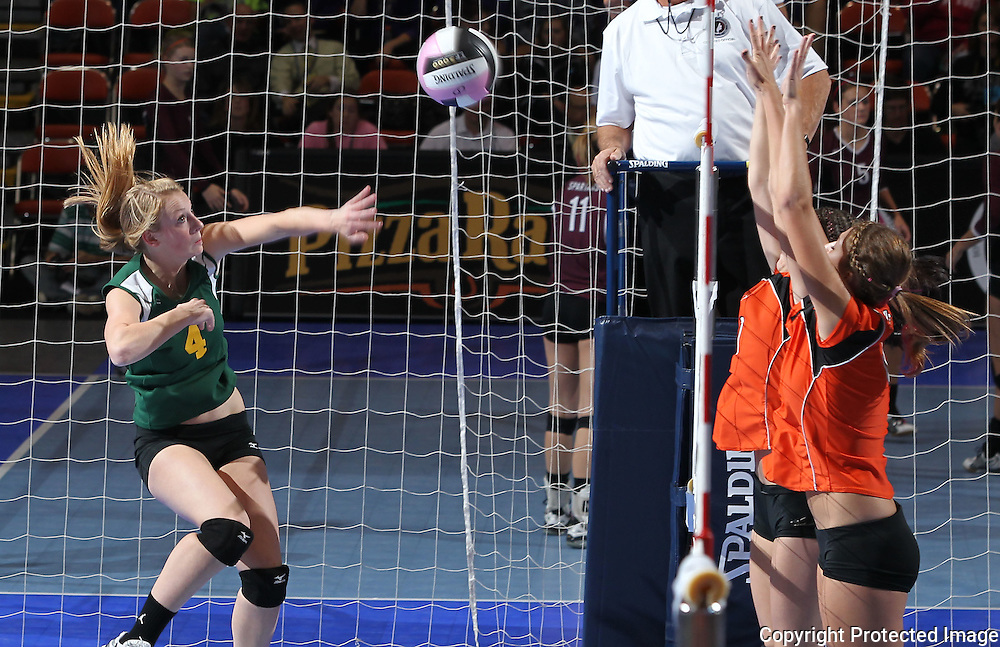 LeMars Gehlen Catholic's Katelin Langel (4) tries to get the ball over the defenders during their 1A semifinal match in the state volleyball tournament at the U.S. Cellular Center at 370 1st Ave E on Friday evening, November 12, 2010. (Stephen Mally/Freelance)