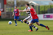 Forest Green Rovers Christian Doidge(9) fends off Dagenham's Shaun Donnellan(27) during the Vanarama National League match between Dagenham and Redbridge and Forest Green Rovers at the London Borough of Barking and Dagenham Stadium, London, England on 11 March 2017. Photo by Shane Healey.