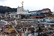 A fishing boat washed up among houses after the tsunami in Ofunato, Iwate, Japan. March 17th 2011