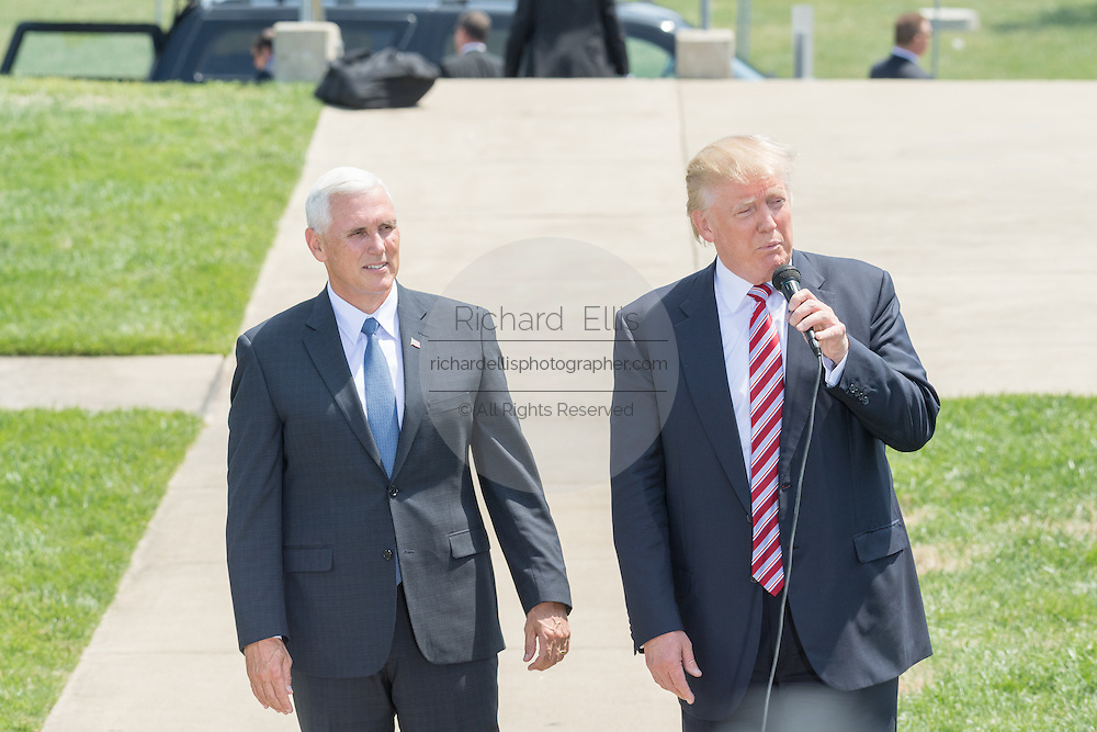 GOP Presidential nominee Donald Trump and Vice Presidential nominee Indiana Governor Mike Pence speak briefly to supporters as he arrives for the Republican National Convention July 20, 2016 in Cleveland, Ohio. Trump flew into the lakeside airport by his private jet and then by helicopter for a grand arrival.