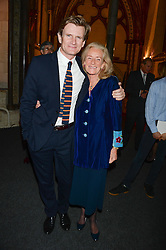 """Downton Abbey actor CHARLES EDWARDS and ROSIE WALKER at a private view to view """"The Coronation Theatre: Portrait of Her Majesty Queen Elizabeth II"""" painted by Ralph Heimans held at Westminster Abbey, London on 12th September 2013."""