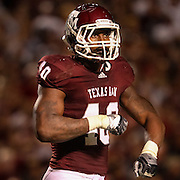 Nov 6, 2010; College Station, TX, USA; Texas A&M Aggies defensive end Von Miller (40) celebrates against the Oklahoma Sooners during the second quarter at Kyle Field. Mandatory Credit: Thomas Campbell-US PRESSWIRE