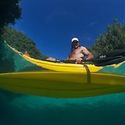 Naturalist Ron Leidich in a kayak at Mandarinfish Lake in Risong Bay, Palau. Ron leads kayak tours through the Rock Islands of Palau.